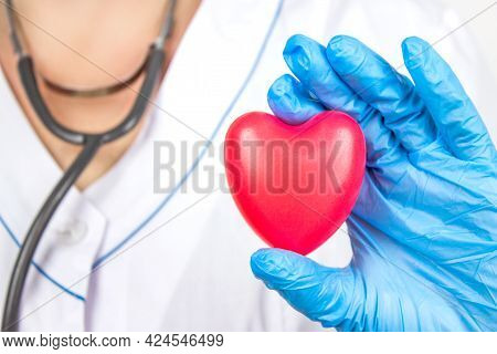 Ambulance. Cardiology Healthcare. Close Up Doctor Hand Holding A Red Heart At Hospital Office. Healt