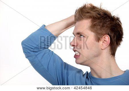 An angry man baring his teeth