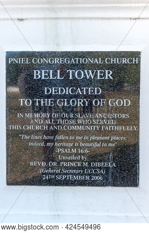 Pniel, South Africa - April 12, 2021: Memorial Plaque On The Bell Tower On The Town Square In Pniel