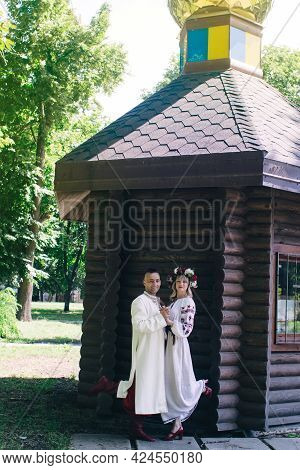 Young People Dressed In Vintage Outfits To Get Married In The Church. Reconstruction Of Cossack Cust