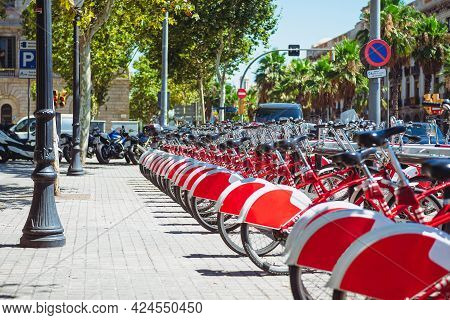 Parking Of Bicycles For Hire. Rent A Bike On Barcelona Street. Spain