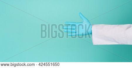 Doctor Hands Wear Blue Latex Glove On Green Mint Or Tiffany Blue Background.he Wear Long Sleeve Gown