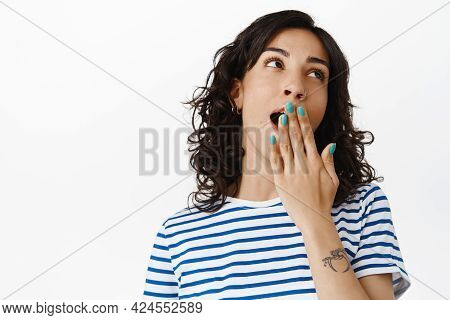 Portrait Of Bored Brunette Girl, Look Away And Yawning With Tired Face, Watching Boring Movie, Stand