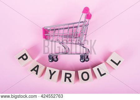 Payroll Word On Wooden Cubes. Concept Of Investment And Savings Money. Wooden Blocks With Letters On