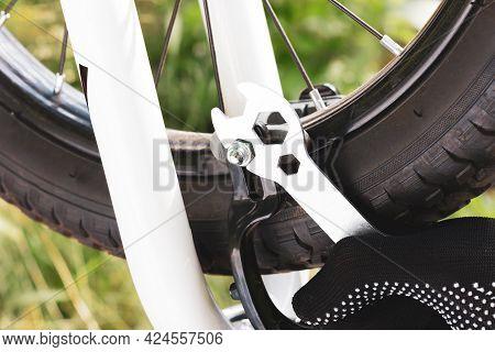 Setting Up A Bicycle Brake. Bicycle Repair. The Mechanic Adjusts The Bicycle Brake. Bicycle Maintena