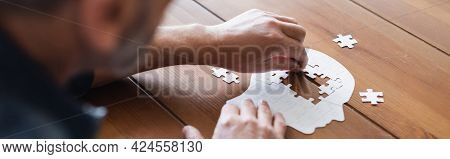 Cropped View Of Blurred Man With Dementia Folding Puzzle, Banner