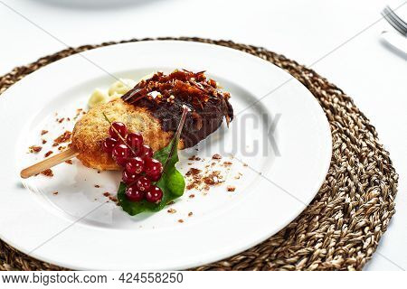 Juicy Kiev Cutlet With Mashed Potatoes, Close-up Of Kiev Cutlet Decorated With A Leaf Of Lettuce And
