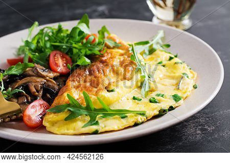 Omelette With Cheese, Green Herbs And Fried Mushrooms On Plate.  Frittata - Italian Omelet