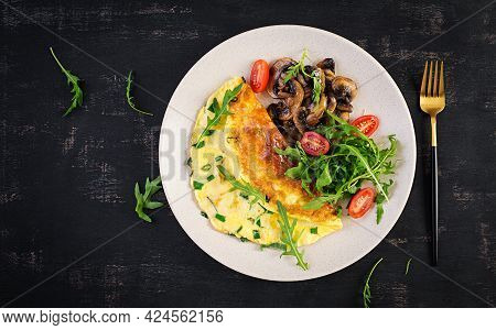 Omelette With Cheese, Green Herbs And Fried Mushrooms On Plate.  Frittata - Italian Omelet. Top View