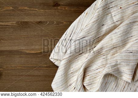 Light Coarse Linen Tablecloth On A Dark Wooden Table