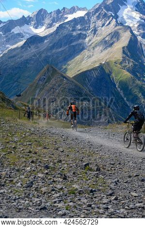 Extreem Outdoor Sport Challenge In French Alps Mountains In Summer, Riding Downhill On Sport Bike On