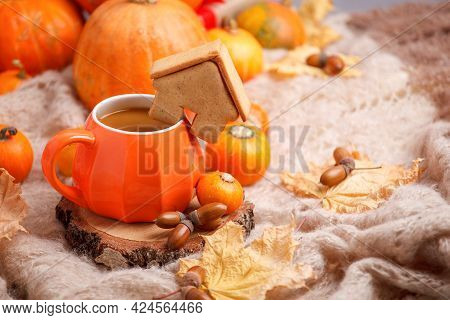 Cup Of Pumpkin Spice Latte With Seasonal Autumn Spices, Gingerbread House Cookies And Fall Decor Fro