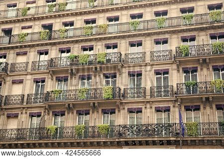 Facade Building With Windows And Balconies. Architecture And Design Concept. European Architecture.