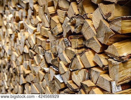 A Textured Solid Background At An Angle Of Birch Firewood Folded In A Dense Stack Extending Into The