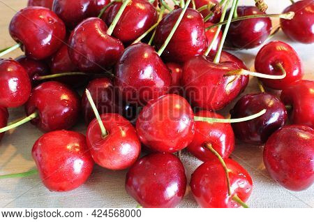 Ripe Cherry Fruits. Close-up Of Sweet Cherry Fruits On A Light Background. Burgundy Cherry Fruits. S