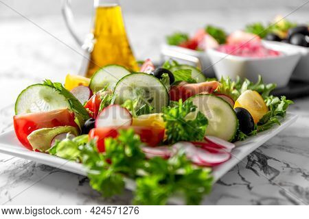 Vegetable Salad And Olive Oil In A Bottle. Fresh Chopped Vegetables In A Salad Bowl. Healthy Eating.