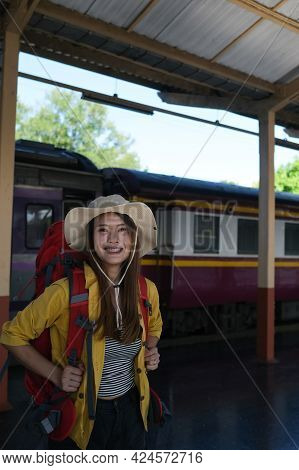 Asian Passenger With Backpack Ready To Start Travel Trip In Chiang Mai, Thailand.