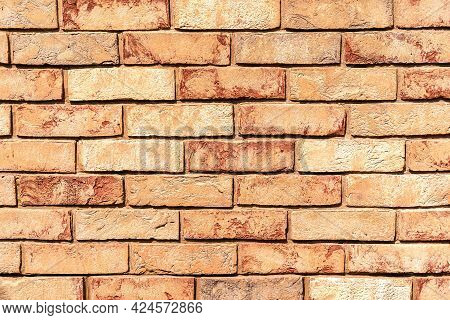Sunlit Weathered Yellow And Red Brick Wall. Brick Texture For Your Design. Copy Space.