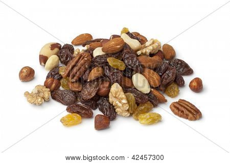 Pile of raisons and nuts on white background