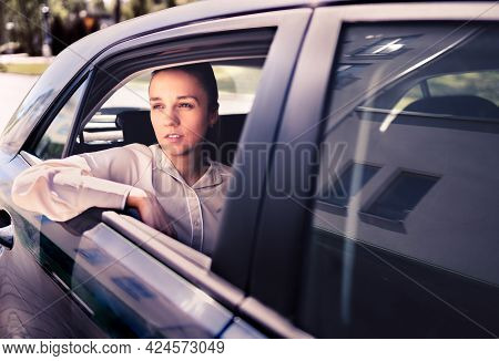 Serious Woman In Car. Sad, Upset Or Tired Taxi Passenger. Cool Elegant Business Lady Sitting On The