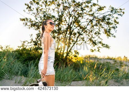 Carefree And Calm Summer. Woman Enjoying Peaceful Evening In Nature. Happy Girl, Natural Beauty Walk