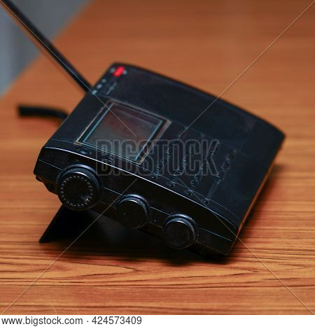 Black Analog Radio Receiver On A Wooden Table
