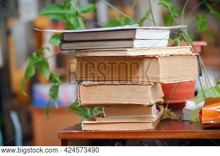 Old Books In A Stack On A Wooden Table. Selective Focus