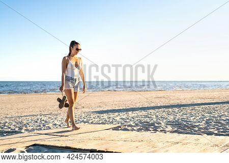 Thoughtful Lonely Woman Walking At An Empty Beach. Thinking About Life At The Peaceful Quiet Sea. Pe
