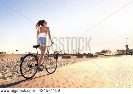 Bicycle Fun On Beach Promenade. Happy Woman Riding Bike On Sunny Summer Boulevard. Seaside Waterfron