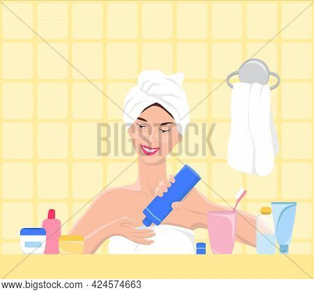 Beautiful Young Woman Squeezes Out Of The Bottle Cream Or Scrub Onto Her Hand. Skin Care Concept. Cl