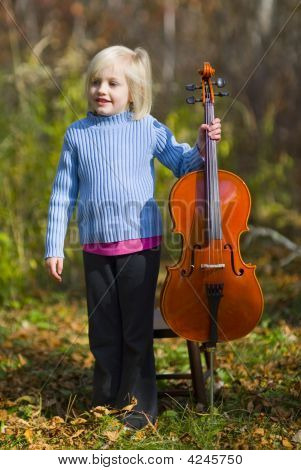 Child Standing With Cello