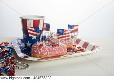 American Independence Day, Celebration, Patriotism And Holidays Concept. Sweet Donut With Candies In