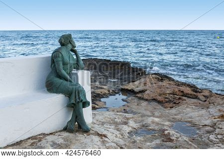 10-05-2021. Torrevieja,alicante,spain. Statue Of La Bella Lola Woman Who Went Out Every Day To Wait