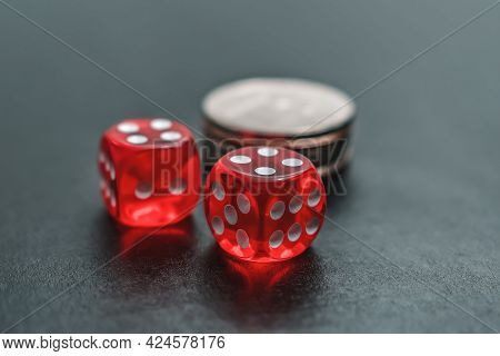 Red Dice And Chips Lie On The Gambling Table For The Casino. Casino Gambling And Home Entertainment