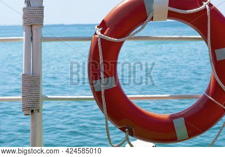 Boat Trip On A Boat, A Lifebuoy On The Background Of The Blue Sea, The View From The Ship. Concept O