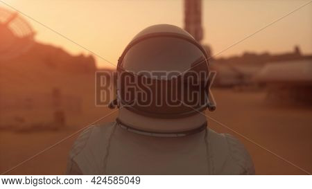 Astronaut On The Planet Mars. Astronaut Walking On The Surface Of Mars. Colonization Concept. 3d Ren