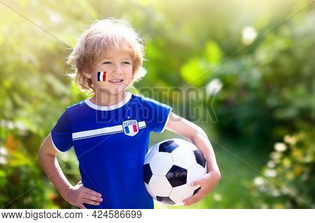 Kids Play Football On Outdoor Field. France Team Fans. Children Score A Goal At Soccer Game. Little