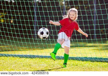 Kids Play Football On Outdoor Field. Portugal Team Fans. Children Score A Goal At Soccer Game. Littl