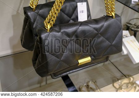 Black Modern Leather Crossbody Bags With Golden Fixtures In Fashion Retail Store Close-up. Elegant S