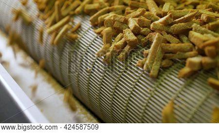 Bread Rusks On The Conveyor. Production Of Bread Crumbs. Preparing Bread Crumbs.