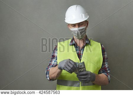 Construction Worker Counting Money