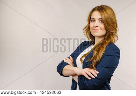 Business Woman Wearing Suit Standing With Folded Arms