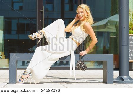 Elegant Fashionable Woman Presenting Trendy Urban Outfit. White Crop Top And Trousers Culottes. Outd