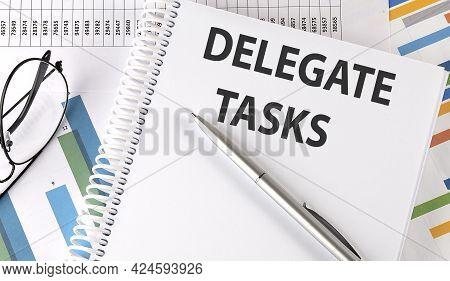 Delegate Tasks , Pen And Glasses On Chart, Business Concept