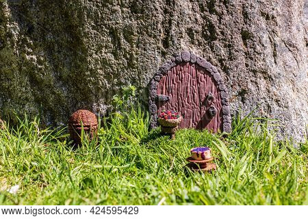 Fairy House Door Made From Clay In Stone Wall.