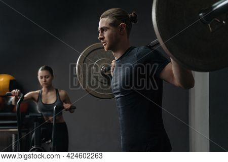 Caucasian Young Sporty Couple Working Out Together At Gym. Group Functional Circuit Training With Sp