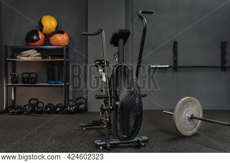 Empty Fitness Gym With Sports Equipment: Air Bike, Barbell, Kettlebells, Dumbbells, Weighted Balls,