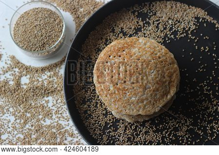 Kodo Millet Pancakes. Pancake Made With A Fermented Batter Of Kodo Millet, Flattened Rice And Coconu
