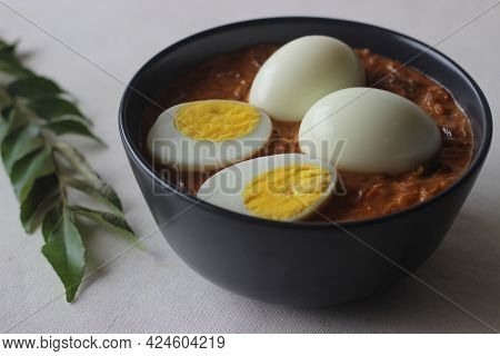 Kerala Style Spicy Egg Curry. Boiled Egg In A Spicy Gravy Of Onions, Tomatoes And Spices. Locally Kn
