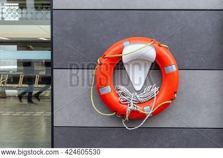 Orange And White Lifebuoy Hanging On The Wall On Marine